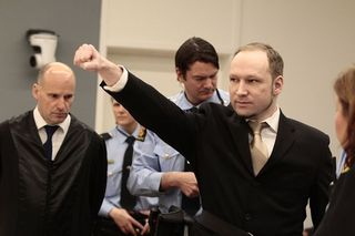 Anders+Behring+Breivik+makes+a+farright+salute+as+he+enters+court